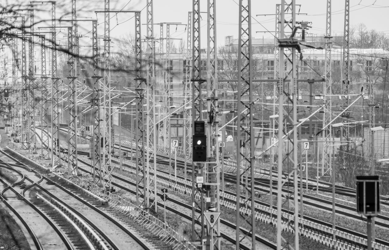 railroad track, rail transportation, transportation, cable, power line, electricity, day, connection, no people, electricity pylon, railway track, outdoors, power supply, public transportation, complexity, nature