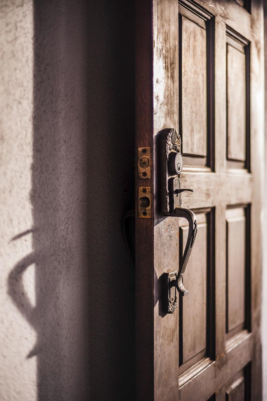 Open Door By Wall