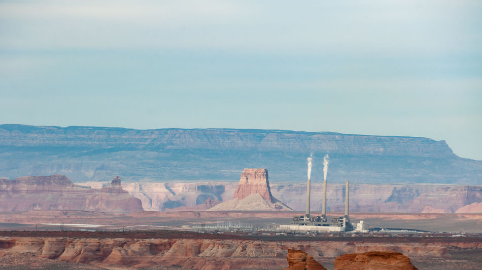 Navajo Generating Station Arid Climate Barren Chimney Coal Power Plant Desert Extreme Terrain Geology Landscape No People Non-urban Scene Outdoors Physical Geography Power Plant Rock Formation Scenics Smokestack Stacks  The Great Outdoors - 2017 EyeEm Awards