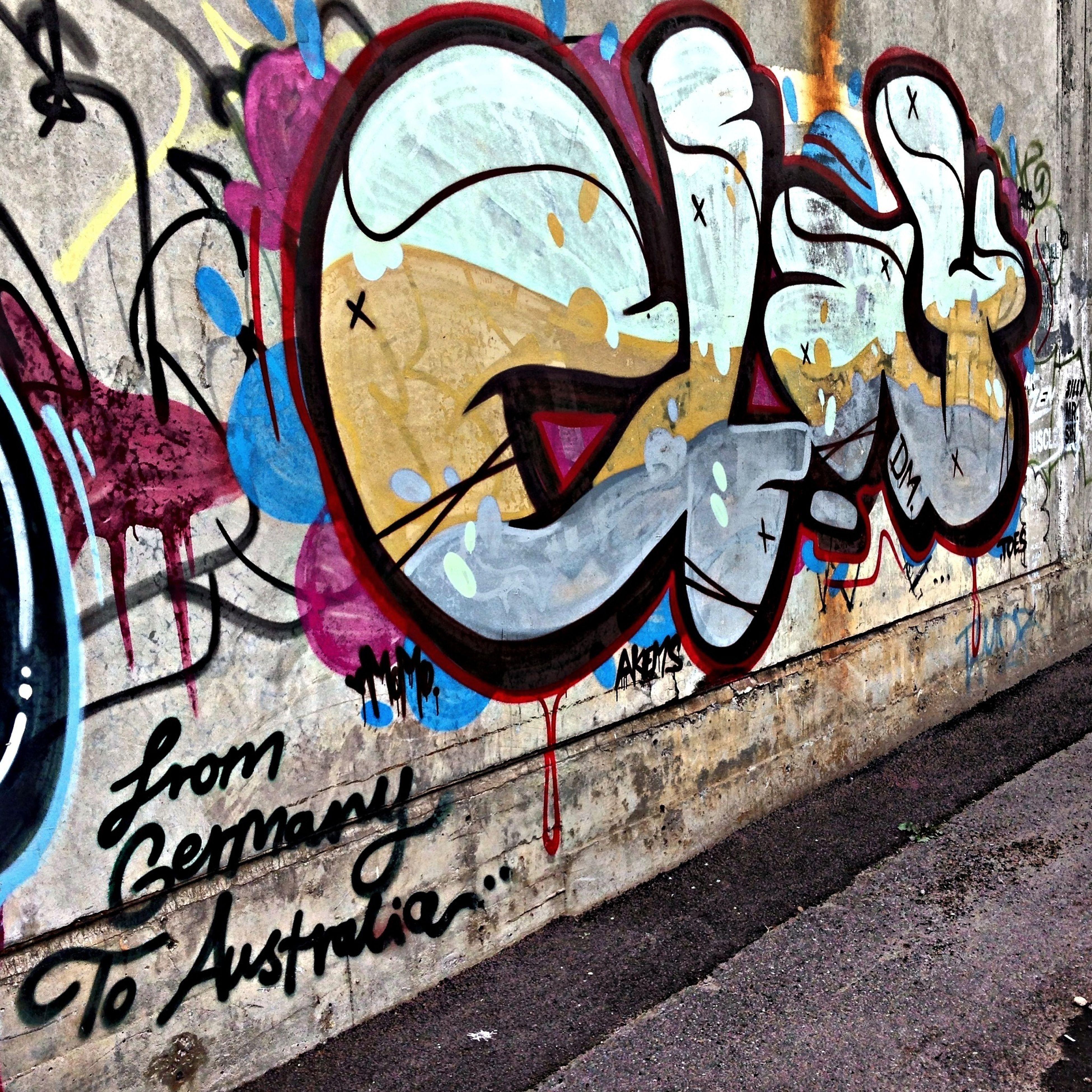 graffiti, creativity, art, art and craft, text, wall - building feature, built structure, architecture, street art, western script, building exterior, multi colored, communication, mural, design, wall, human representation, vandalism, pattern, day