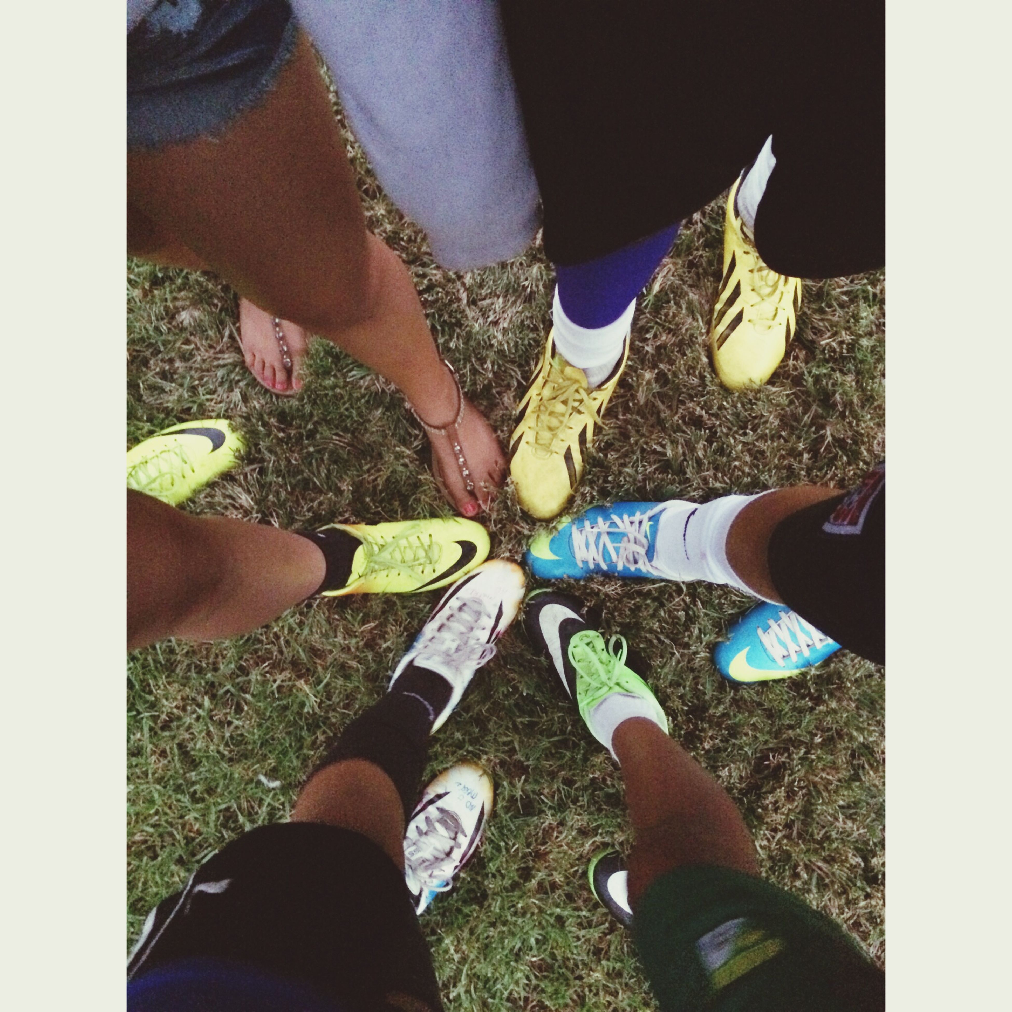 low section, person, lifestyles, personal perspective, transfer print, leisure activity, shoe, togetherness, men, human foot, standing, auto post production filter, high angle view, bonding, friendship, footwear