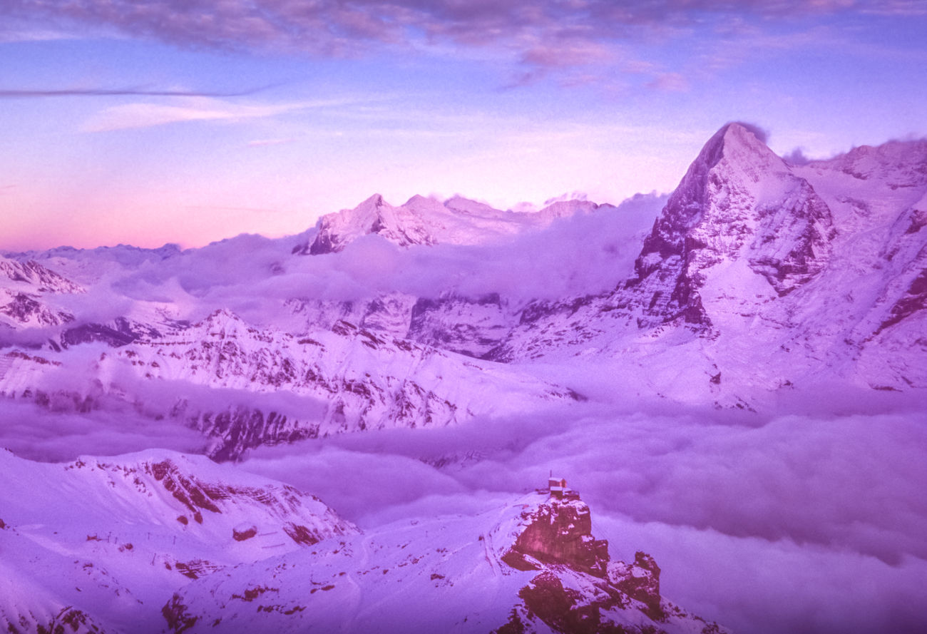 """Soft light falls over the north face of the Eiger, an imposing 3,970-metre (13,020 ft) mountain that forms part of the Bernese Alps looking over the valleys of Grindelwald and Lauterbrunnen. Its precipitous northern wall, known as the Eigerwand or Nordwand, is at 1,800-metres (5,900 ft) the biggest north face in the Alps. First climbed in 1935 it is subject to several famous movies and books. It is often cynically referred to as Mordwand, which translates to """"murder wall"""", as it is taken the lives of at least sixty-four climbers. Bernese Oberland, Canton of Bern, Switzerland Shot on Fuji Velvia slide film. Love Life, Love Photography Alps Bern Berne Bernese Clouds Eiger Eigerwand Fog Grindelwald Hut Ice Inversion Jungfrau Lauterbrunnen Mist Mountain Mountains Nordwand Oberland Peak Rock Rocks Snow Swisse Switzerland The Great Outdoors"""