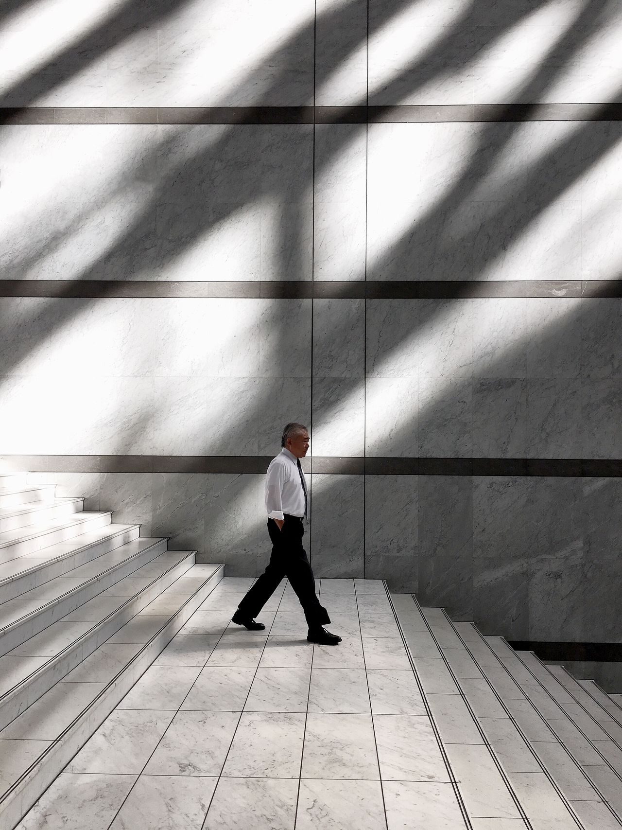 🚶🏻 Businessman Only Men Architecture Strideby Minimal Walking Minimalism Light And Shadow IPhoneography Minimalobsession Streetphotography Minimalist City Street