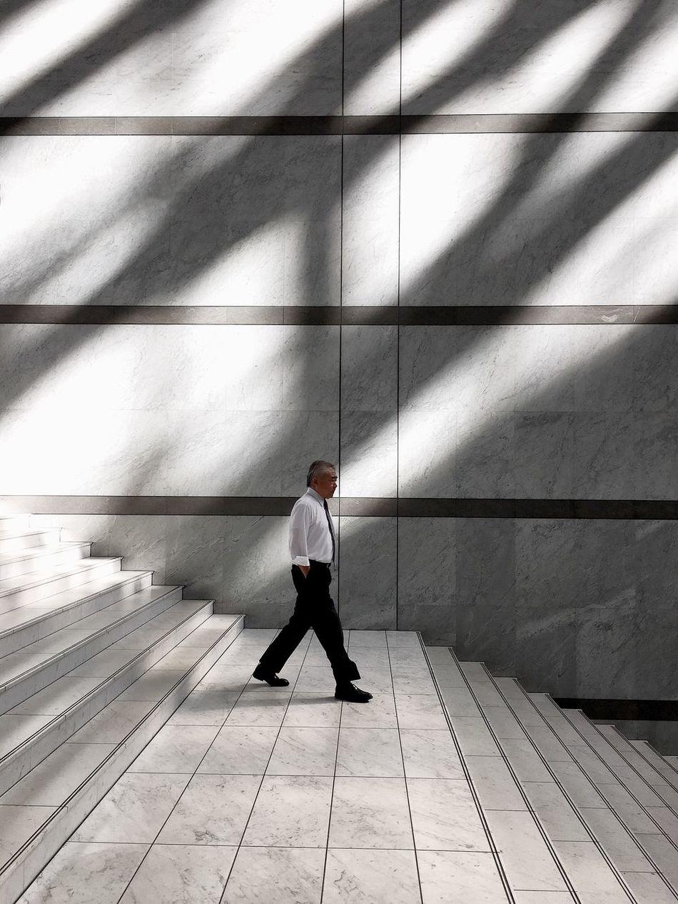 🚶🏻 Businessman Only Men Architecture Strideby Minimal Walking Minimalism Light And Shadow IPhoneography Minimalobsession Streetphotography Minimalist City Street
