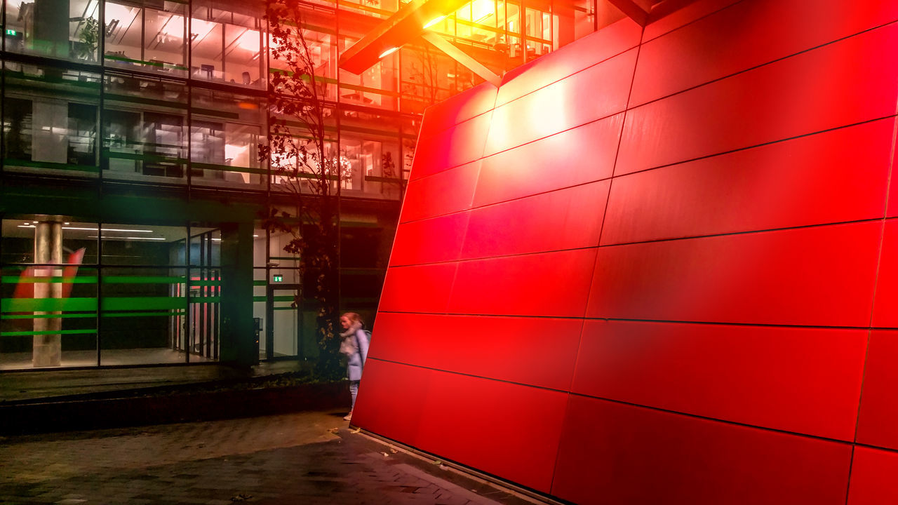 I See Red Built Structure Business Hamburg St. Georg Handy Photo Illuminated Lights Move Night Night Photography Office Building Red Red Wall Woman
