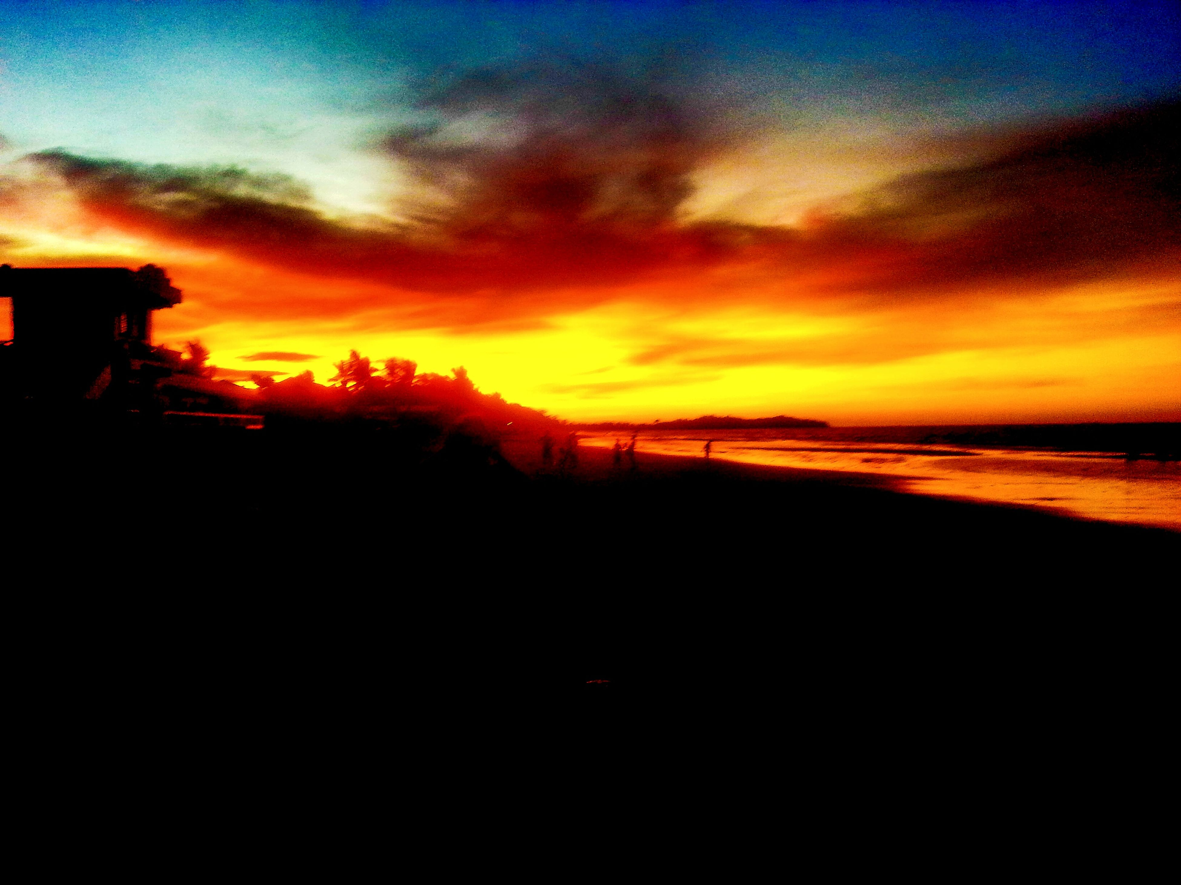 sunset, silhouette, orange color, scenics, sky, beauty in nature, tranquil scene, tranquility, idyllic, dramatic sky, nature, cloud - sky, dark, landscape, dusk, cloud, moody sky, outdoors, majestic, atmospheric mood