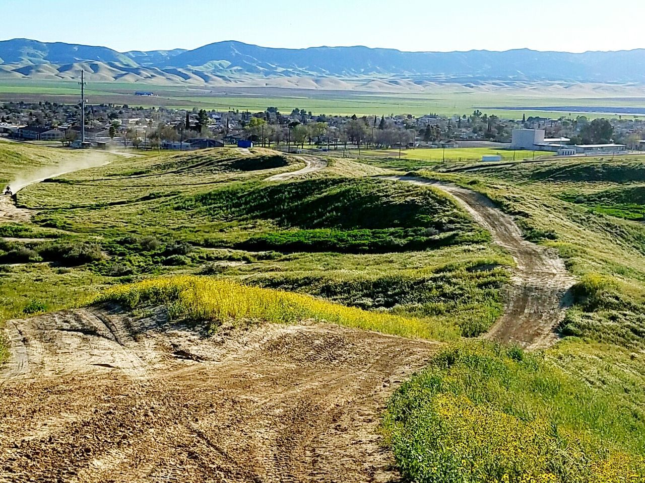 Dirt Road Outdoors Landscape Rural Scene Sky Mountain Field Day The Hills Avenal, California Fun Things To Do Clear Skies First Signs Of Spring Recreational Activity Blue Sunlight United States California Central Valley Area Boy Riding ATV Green Grass Flowers Shrubs Outdoor Sports Riding Around Sunshine And Shadows Sunny