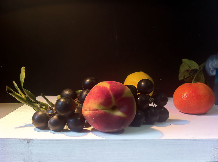 still life with fruit arranged as a painting of 16th century dutch or flemish masters of painting Apple Apple - Fruit Basket Close-up Cuiaroscuro Focus On Foreground Food Freshness Fruit Grape Green Color Healthy Eating Juicy Mandarine No People Organic Peach Red Ripe Stem Still Life Winegrapes