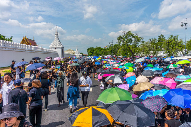 People shelter from the sun outside the Grand Palace. Adult Bangkok City Cloud - Sky Day Horizontal King Bhumipol Adulyadet Large Group Of People Multi Colored Outdoors People Person Sky Thailand Umbrella Umbrellas
