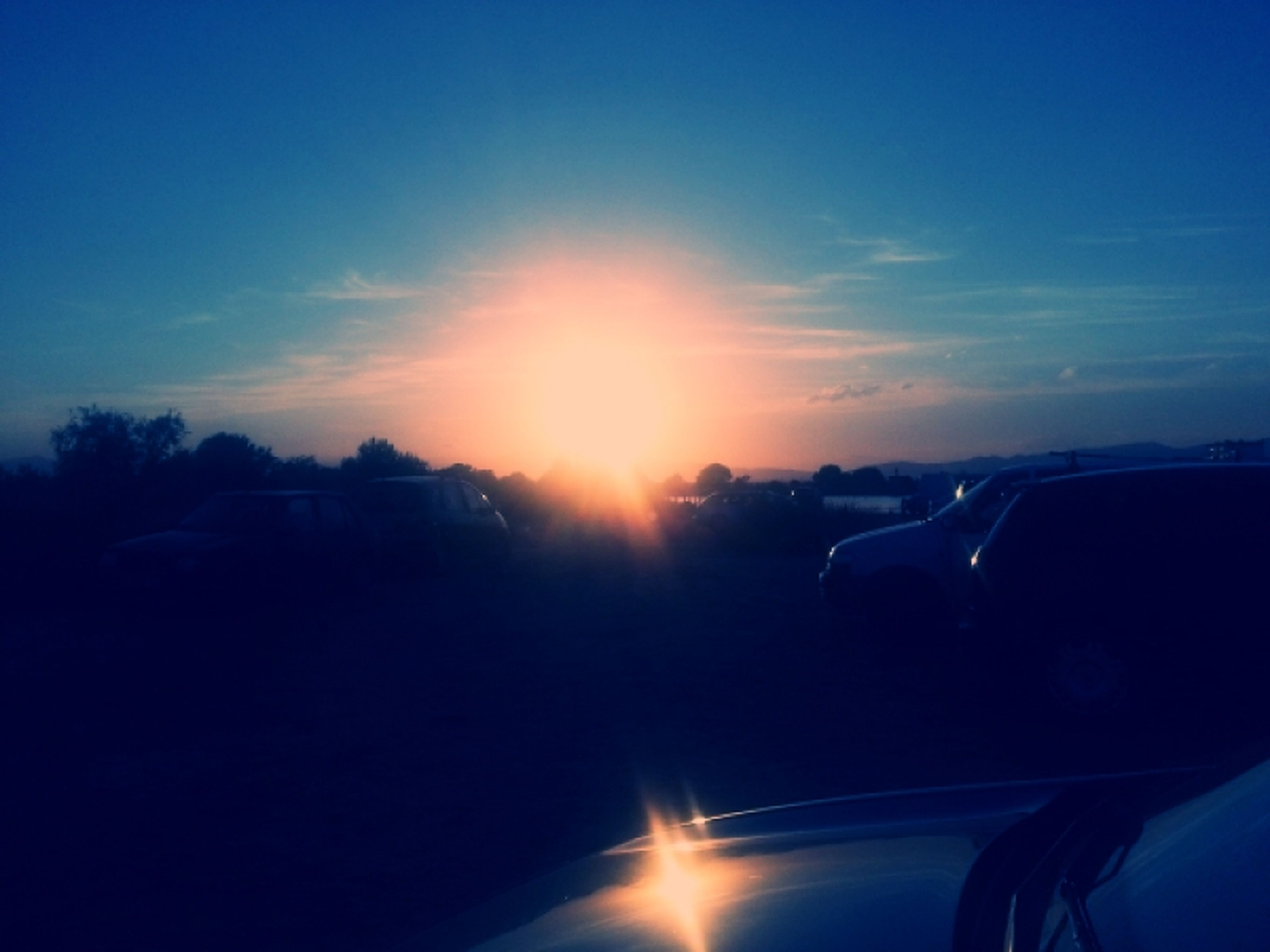 sun, transportation, sunbeam, sunlight, lens flare, mode of transport, car, sunset, land vehicle, sky, vehicle interior, silhouette, part of, travel, nature, windshield, cropped, blue, car interior, beauty in nature