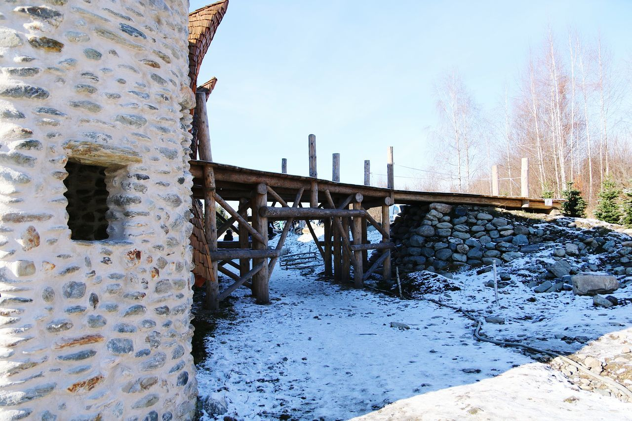 Sky Architecture History Snow Winter Outdoors No People Day Travel Destinations Abandoned Built Structure Building Exterior Tree Cold Temperature Nature Castle Fairy Architecture Wood Art Bridge - Man Made Structure Bridge