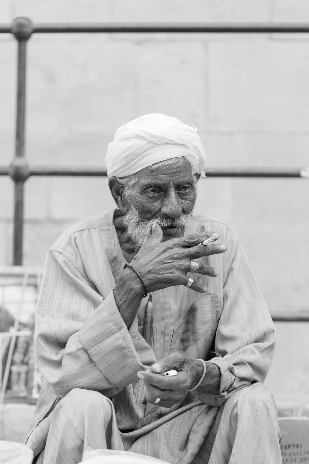 Adult Black And White Blackandwhite Cairo Casual Clothing Cigarette  Cigrettes Egypt Egyptian Egyptian-Faces Focus On Foreground Hat Lifestyles Man Mature Men Old Outdoors Senior Senior Portrait Street Photography Streetphotography Warm Clothing