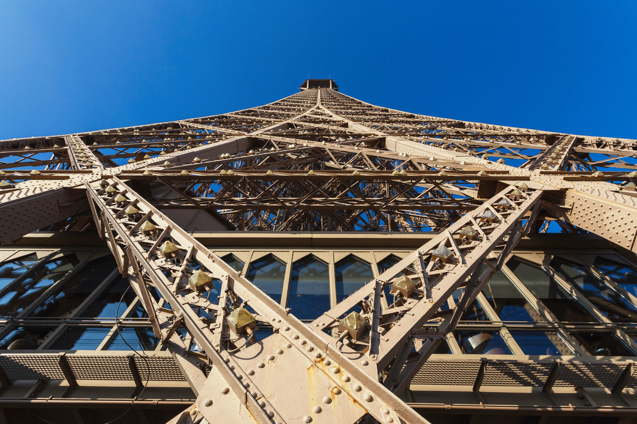 Eiffel Tower in Paris, bottom view against clear blue sky Architecture Blue Sky Built Structure Capital City Eiffel Tower Famous Place Famous Places High Low Angle View Metalwork No People Outdoors Rat View Sky Steel Steel Structure  Tall Tourism Tourist Attraction  Tower Travel Destinations Travel Destnations Unusual Visit