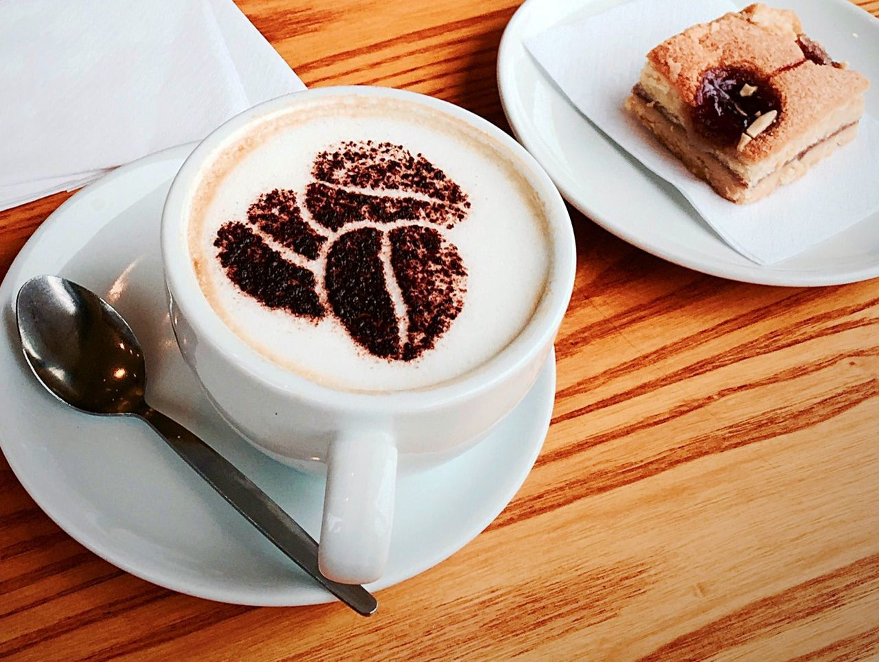 coffee cup, coffee - drink, food and drink, table, saucer, drink, dessert, plate, sweet food, high angle view, freshness, food, cappuccino, frothy drink, indulgence, refreshment, indoors, brown, no people, unhealthy eating, froth art, temptation, latte, close-up, day, ready-to-eat