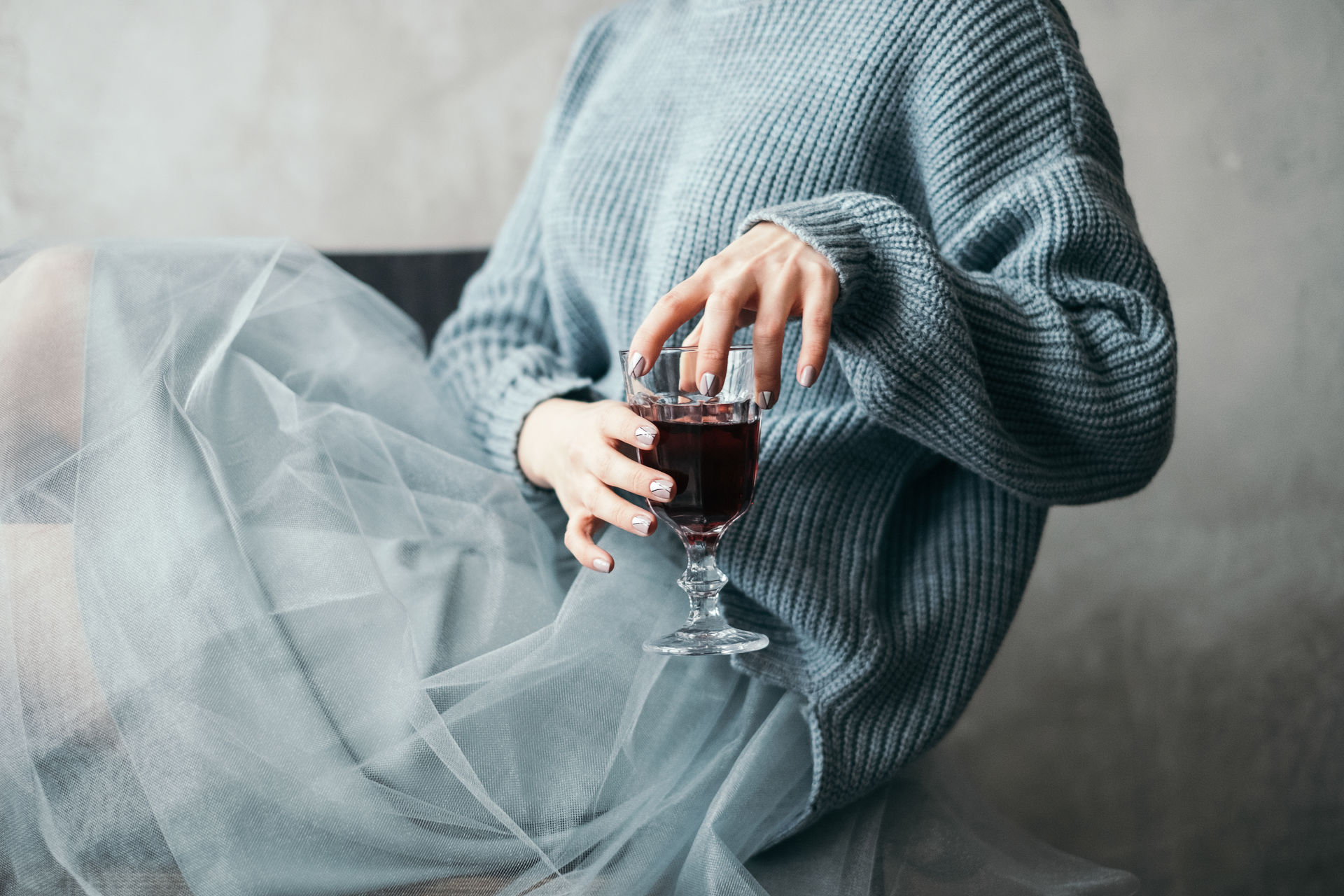 elegant woman holding glass of red wine Copy Space Red wine Well dressed alcohol close-up drink drinking drinking glass Drinking water elegante Food and Drink grey indoors midsection one person pastel colors real people Refreshment Sitting