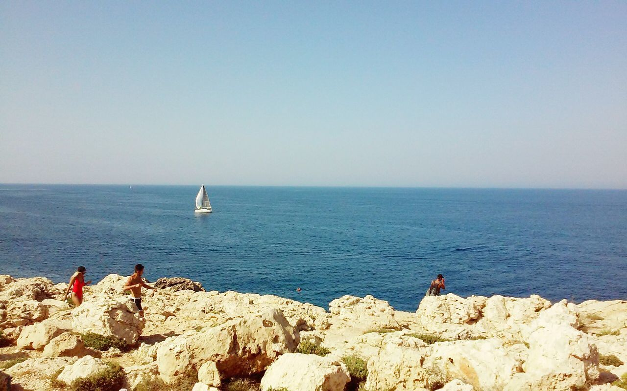 Concept Horizon Over Water Blue Sky Blue Sea Rocks People Traveling Travel Photography Boat Sails Sailing Minimalism Minimal Clear Waters Descovering Places