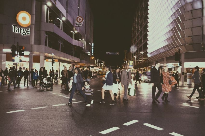 Vintage Crossing Built Structure City City Life City Street Crowd Group Of People Illuminated Large Group Of People Leisure Activity Lifestyles Medium Group Of People Mixed Age Range Modern The Way Forward Travel Destinations