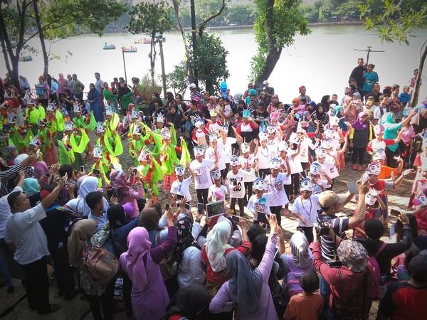 1). Dancing by the lake of Babakan | @Amazing Sunday Dance with 1240 participating kids. Colosal Traditional Costume Traditional Culture Cultural Dance On Street Observing People Gathering Kids Dance People People Watching Sunday Mass in Jakarta, Indonesia