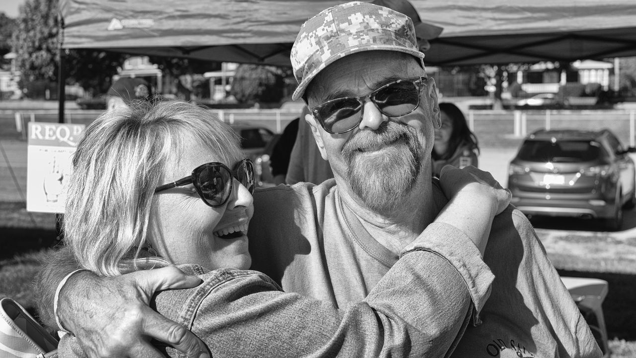 sunglasses, real people, togetherness, senior adult, happiness, senior women, mode of transport, two people, land vehicle, transportation, love, smiling, day, outdoors, bonding, lifestyles, portrait, beard, looking at camera, eyeglasses, young adult, young women, close-up, adult, people