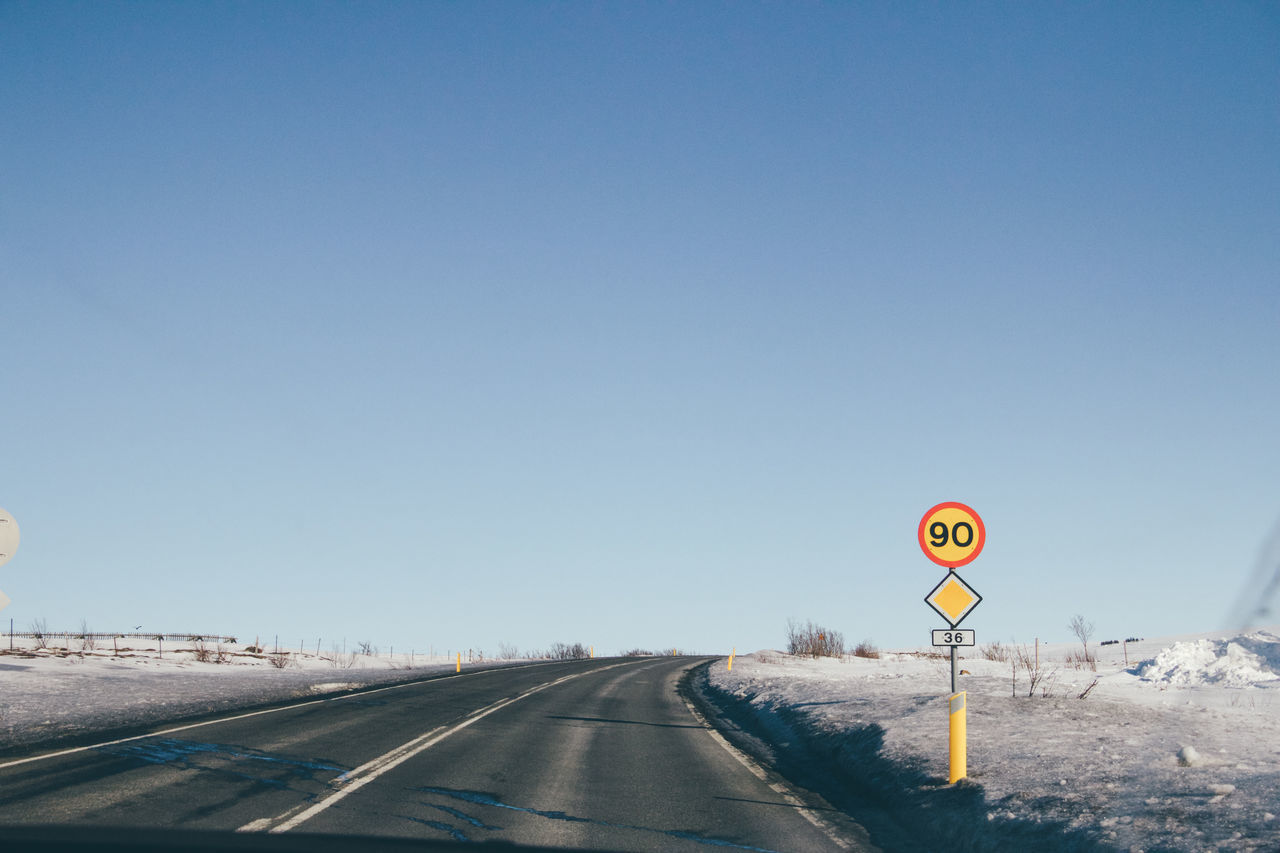 Clear Sky Communication Day Iceland Nature No People Number On The Road Outdoors Road Road Road Sign Road Trip Roadtrip Sky Snow Speed Limit Speed Limit Sign Text The Way Forward Transportation Travel