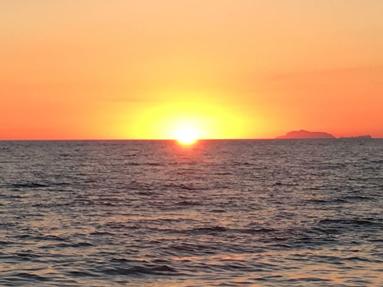 sunset, sea, sun, scenics, beauty in nature, nature, orange color, tranquility, tranquil scene, idyllic, horizon over water, no people, outdoors, sunlight, water, sky, rippled, silhouette, clear sky, wave, day