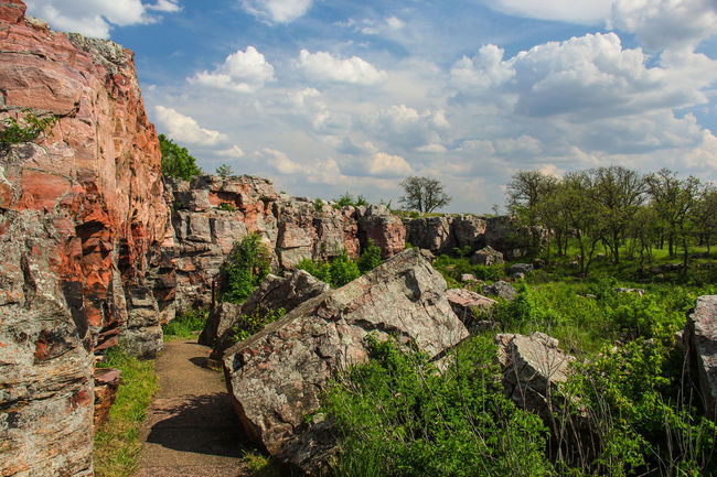 Rock outcropping. Blue Sky Canon60d Canonphotography Clouds Cloudy EyeEm Gallery Geology Green Landscape Nature Pipestone Pipestone National Monument Rock Rock Formation Rock Outcrop Sioux Quartzite Stone Summer Tranquil Scene Trees