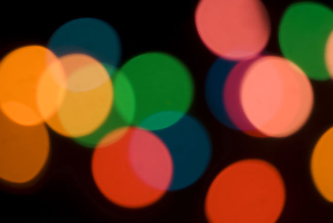 Bokeh of colorful party lights in red, orange and green for a festive background for a celebration or holiday Abstract Background Backgrounds Blurred Blurry Blurs Bokeh Circle Circles Circular Closeup Colored Colorful Colors Decoration Decorative Details Green Illuminated Red Round Yellow