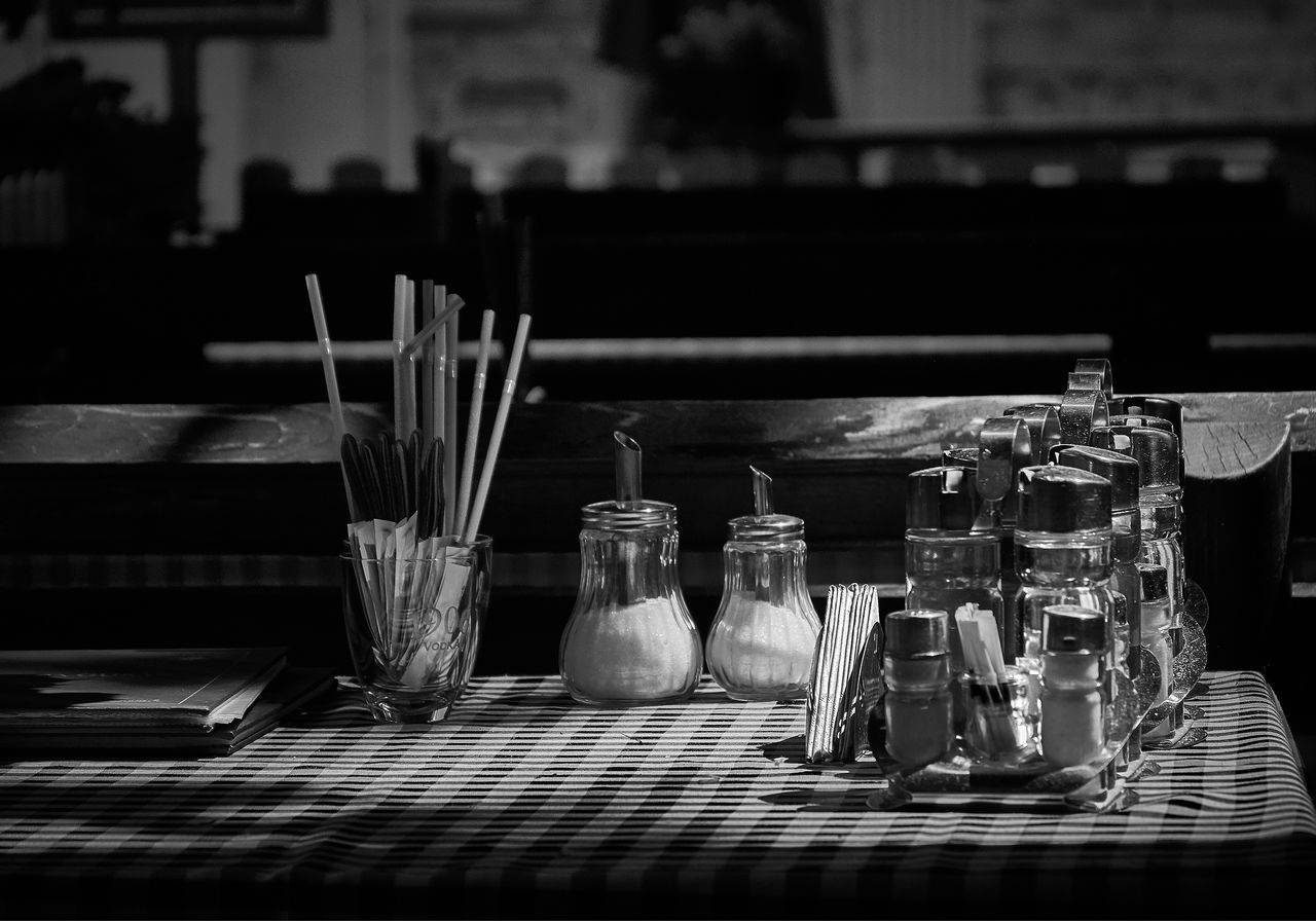 table, indoors, no people, bottle, drinking glass, close-up, day