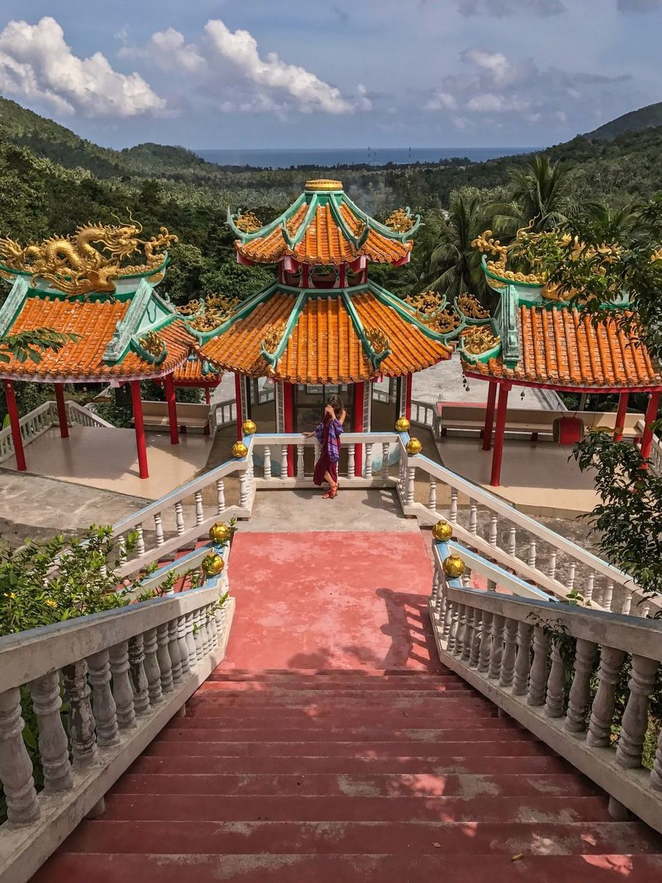 Architecture Built Structure Place Of Worship Sky Travel Destinations Day Outdoors Cloud - Sky Spirituality Full Length Women Maxi Dress Temple - Building Chinese Temple Buddhist Temple Mountains Scenics Tourist Attraction  Traveling Ko Phangan Real People Men One Person People Adult