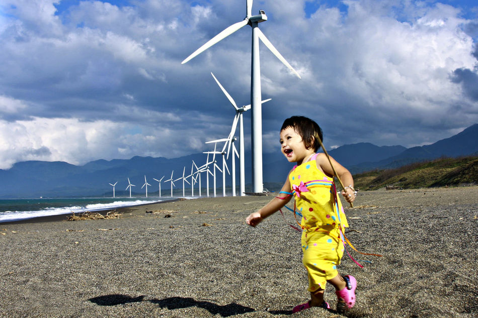 Windmill fun Bangui Windmills  Casual Clothing Cloud Cloud - Sky Clouds And Sky Cloudy Day Enjoyment Full Length Fun Happy Kid Kids Being Kids Leisure Activity Lifestyles Nature Outdoors Playing Outdoors Portrait Scenics Shore Sky Tranquility Travel Destinations Vacations Windmill