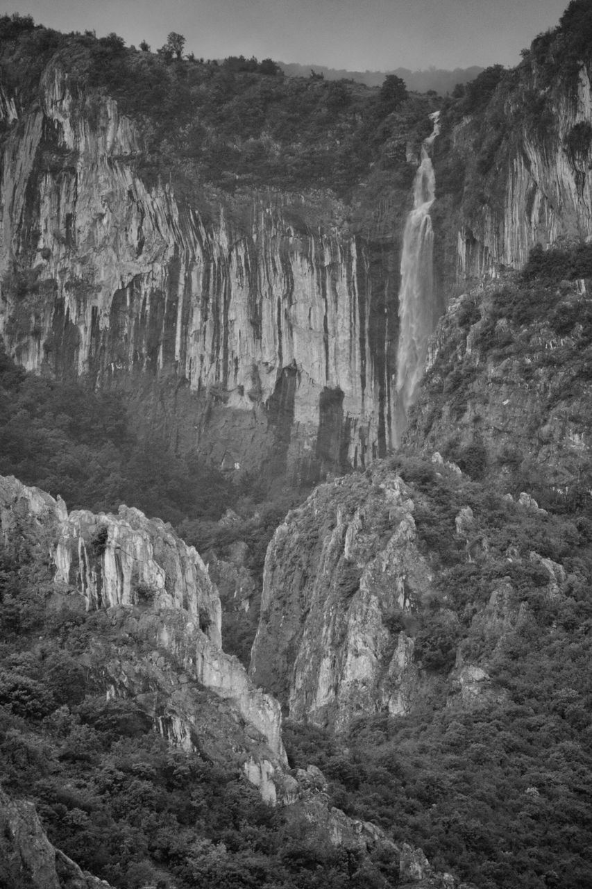 rock - object, rock formation, nature, geology, physical geography, cliff, beauty in nature, scenics, travel destinations, no people, outdoors, travel, day, waterfall, cave, low angle view, sky