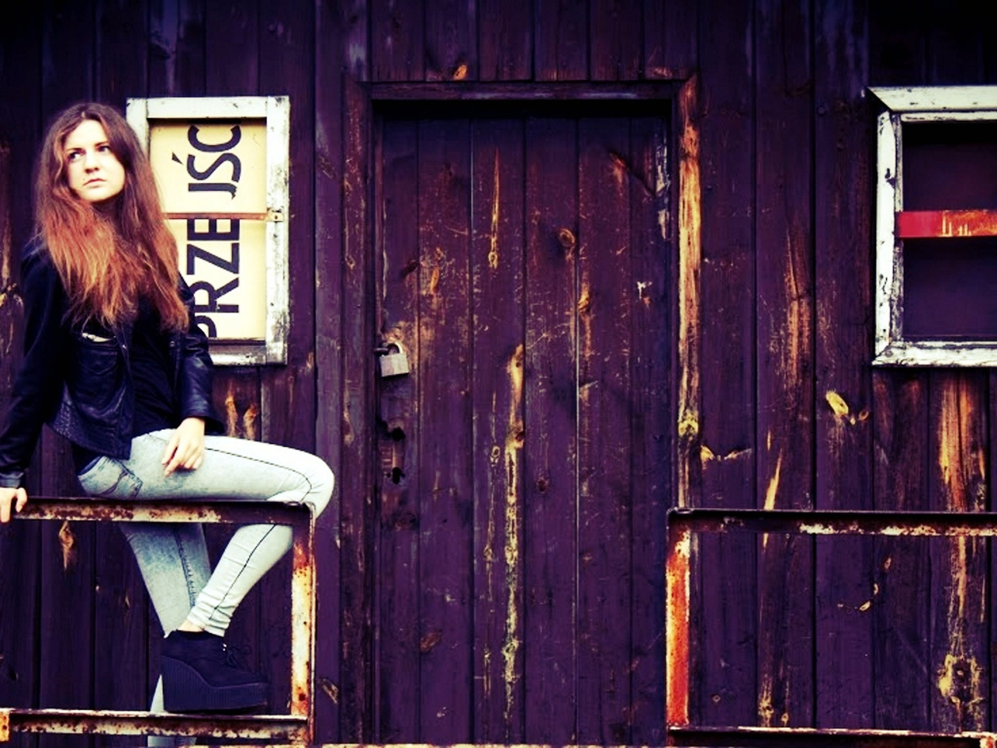 young adult, lifestyles, person, building exterior, built structure, casual clothing, standing, architecture, door, front view, young women, leisure activity, house, three quarter length, waist up, wood - material, long hair, portrait