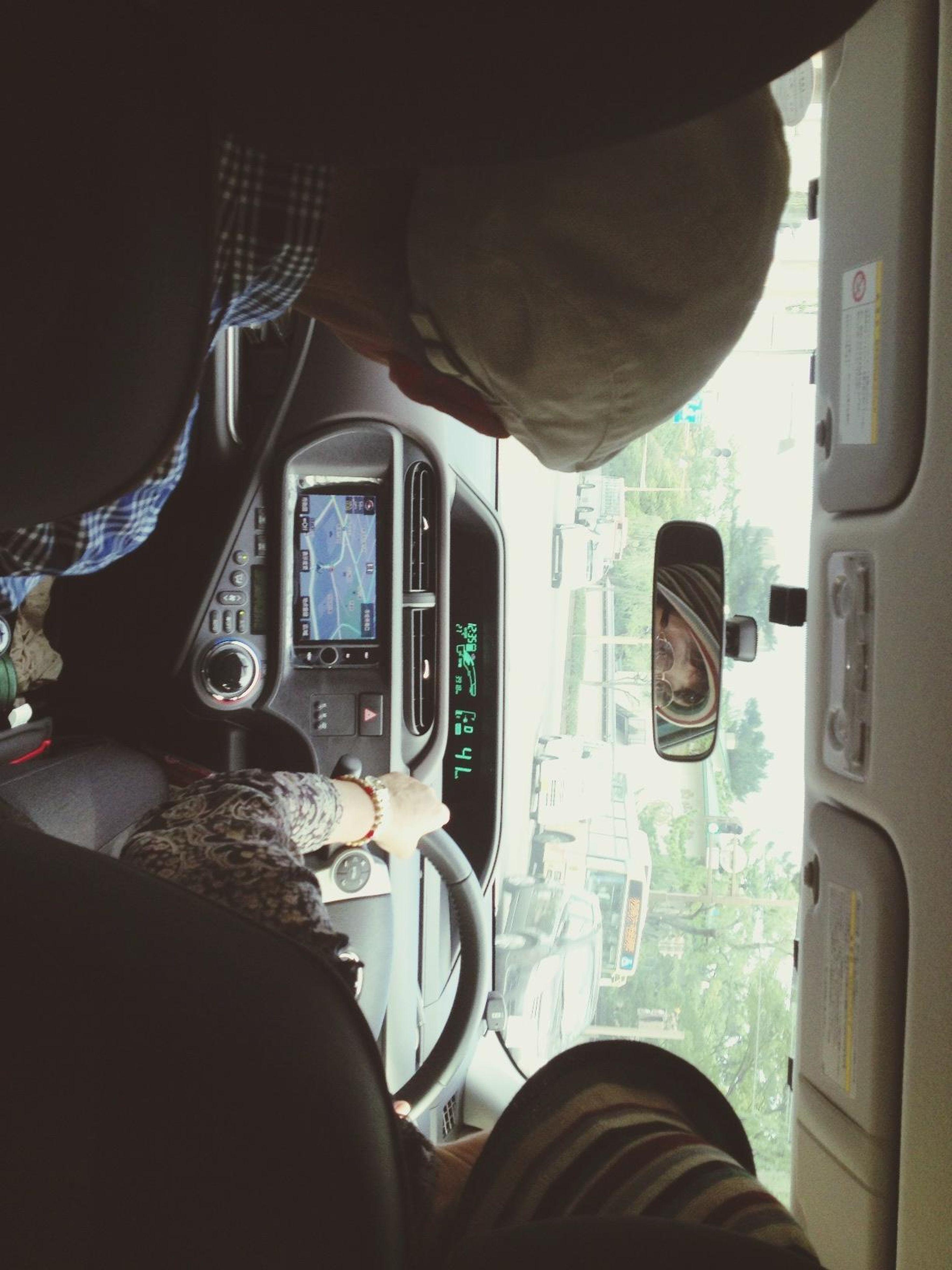 transportation, mode of transport, vehicle interior, indoors, land vehicle, men, car, lifestyles, window, vehicle seat, travel, leisure activity, sitting, journey, bus, person, technology, public transportation