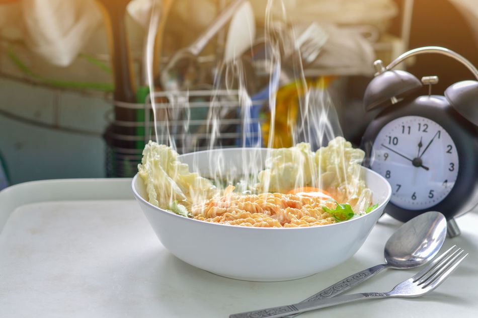 Hot noodle and smoke with clock set waiting Bowl Close-up Day Focus On Foreground Food Food And Drink Fork Freshness Healthy Eating Indoors  No People Ready-to-eat Table