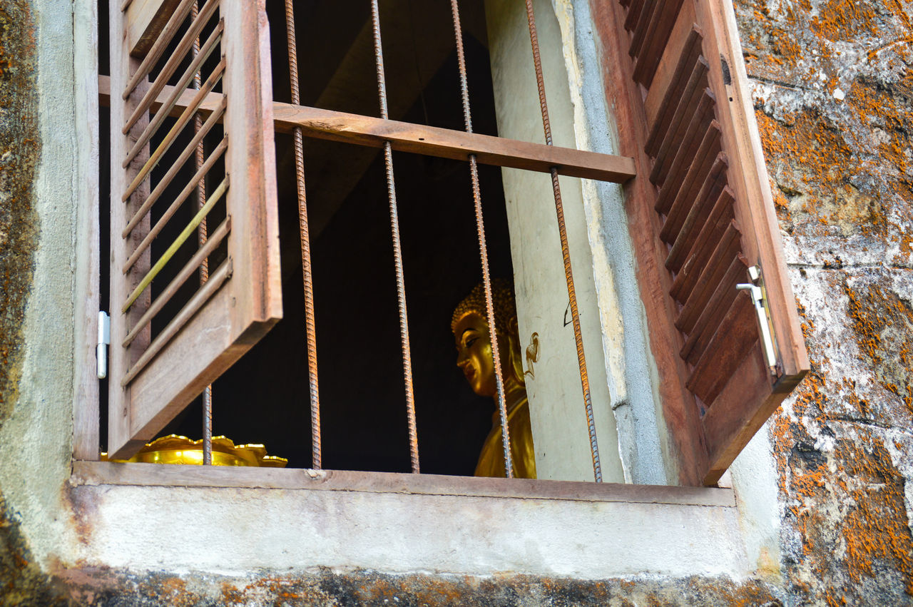 EyeEm Selects Unique Perspectives Window Day Indoors  No People Architecture Built Structure Close-up Golden Buddha Statue Looking Into A Window Behind Bars Irony Freedom Freedom Of Religion Religion And Beliefs Kampot, Cambodia Old Town Old Buildings