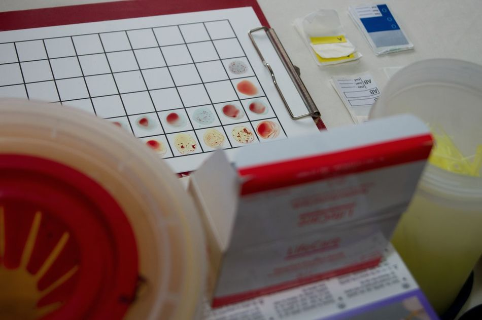 Blood grouping slides Red Close-up Person Blood Donor Technology Blood Grouping Blood Glucose Level Blood Crossmatching Blood Investigation Blood Test Needle Prick Occupation Blood Job No People High Angle View