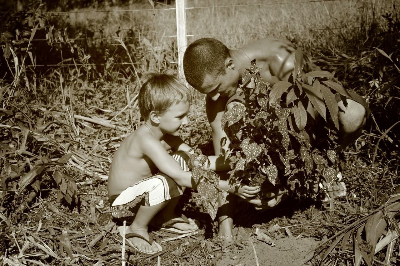 Black And White Blackandwhite Bonding Care Child Day Family Father & Son Father And Son Fatherhood Moments Love Nature People Plant Planting Planting Seeds Planting Trees Plants Plants And Flowers Togetherness