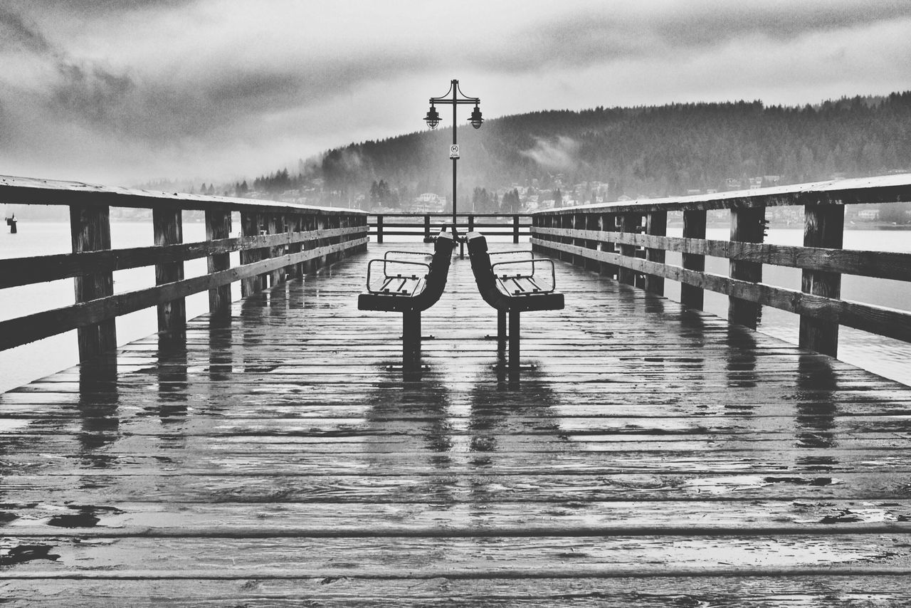 Sky Water Cloud - Sky Built Structure Architecture Sea Day Nature Outdoors No People Beauty In Nature Pier Dock Wooden Material Bench Cloudy Wet Rain Rainy Symmetry Railing Vancouver Canada British Columbia Black And White