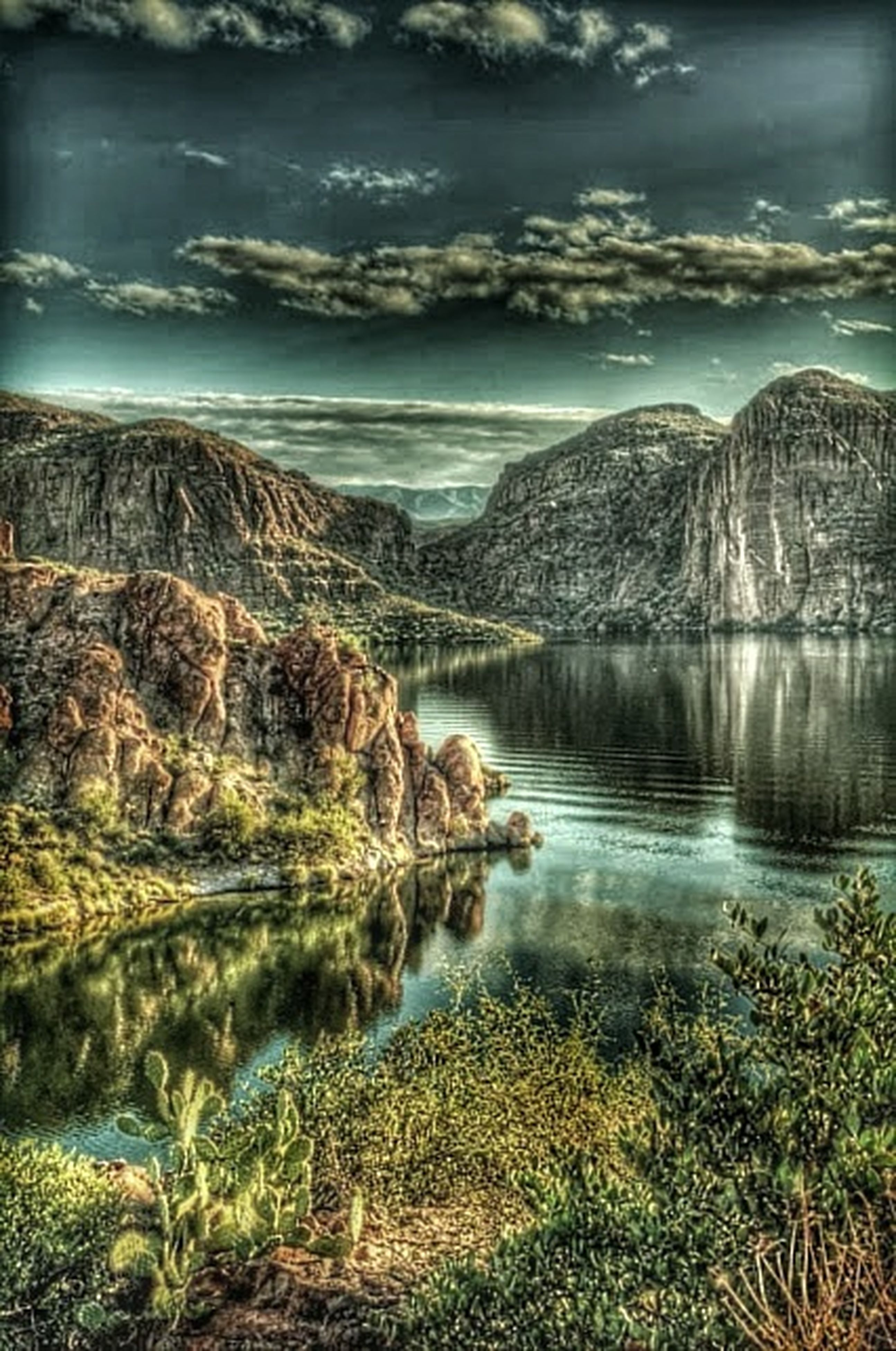 water, tranquil scene, tranquility, scenics, mountain, beauty in nature, nature, rock - object, rock formation, lake, sky, mountain range, idyllic, reflection, physical geography, non-urban scene, river, geology, landscape, rock