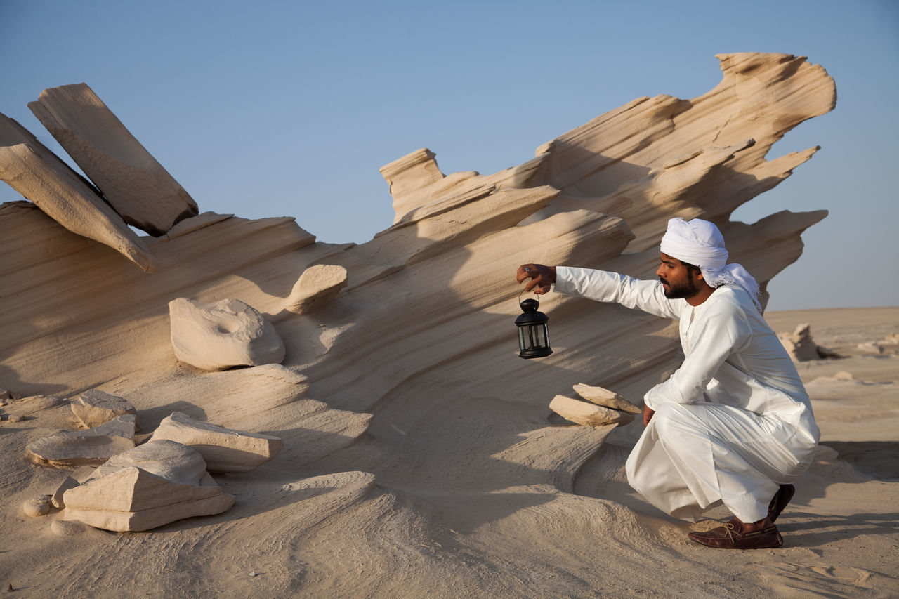 Clear Sky Day Desert Eid Full Length Leisure Activity Lifestyles Men Nature One Person Outdoors People Ramadan  Real People Sand Shadow Sky Sunlight Young Adult