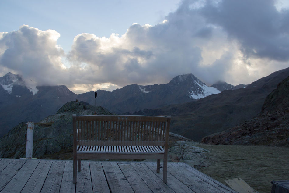 """""""place to relax"""" Alps Bench Cloud - Sky Clouds Day Deck Furniture Hiking Hikingadventures Landscape Mountain Mountain Range Mountains Nature Nature No People Outdoor Outdoors Radiator Relax Relaxing Moments Scenery Science Social Issues Wood"""