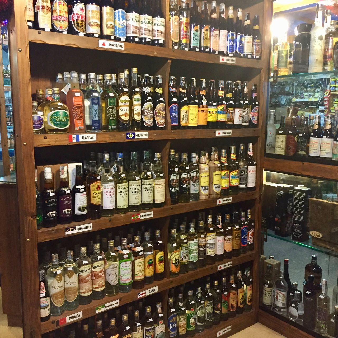 From many Brazilian states, sugarcane liquor. Abundance Alcohol Arrangement Bottle Brazil Brazilian Drinks Cachaça Caipirinha Choice Drink For Sale In A Row Indoors  Large Group Of Objects Liquor Store Liquorstore No People Order Shelf Spirituosen Variation