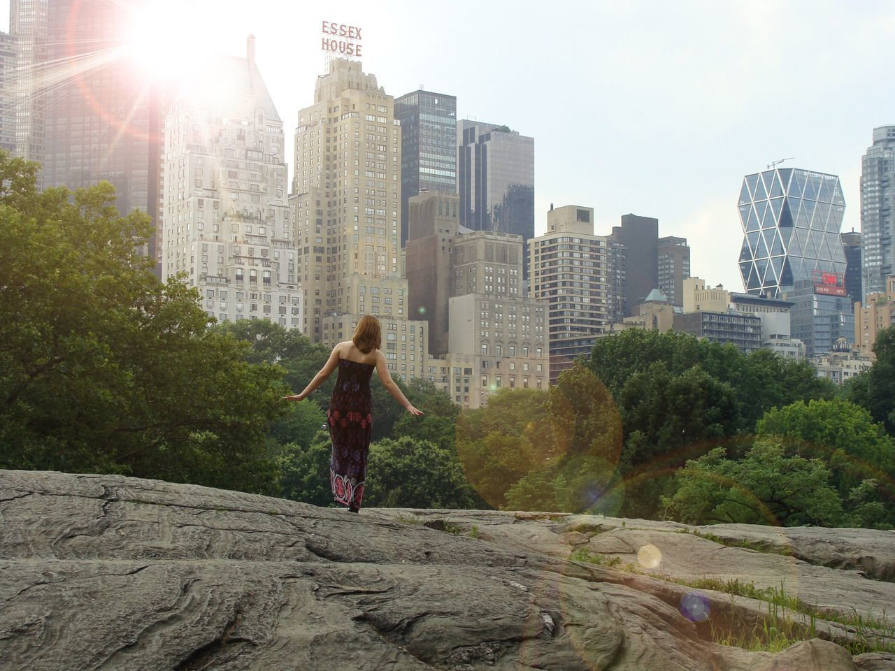 The girl in Central Park building exterior Architecture built structure lens flare one person day City Tree real people Standing outdoors sky Sunlight only women Adapted to the City