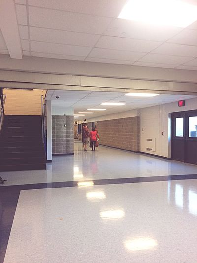 Cute Couple Giant Teddy Bear Homecoming Young Love Red Shirt HoCo Stairs High School Exit Sign Door Lockers Band Kid Life
