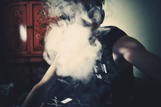 Indoors  Human Face In Front Of Front View Young Adult Casual Clothing Mask - Disguise Hiding Smoke Domestic Life Mature Adult Taboo Intriguing