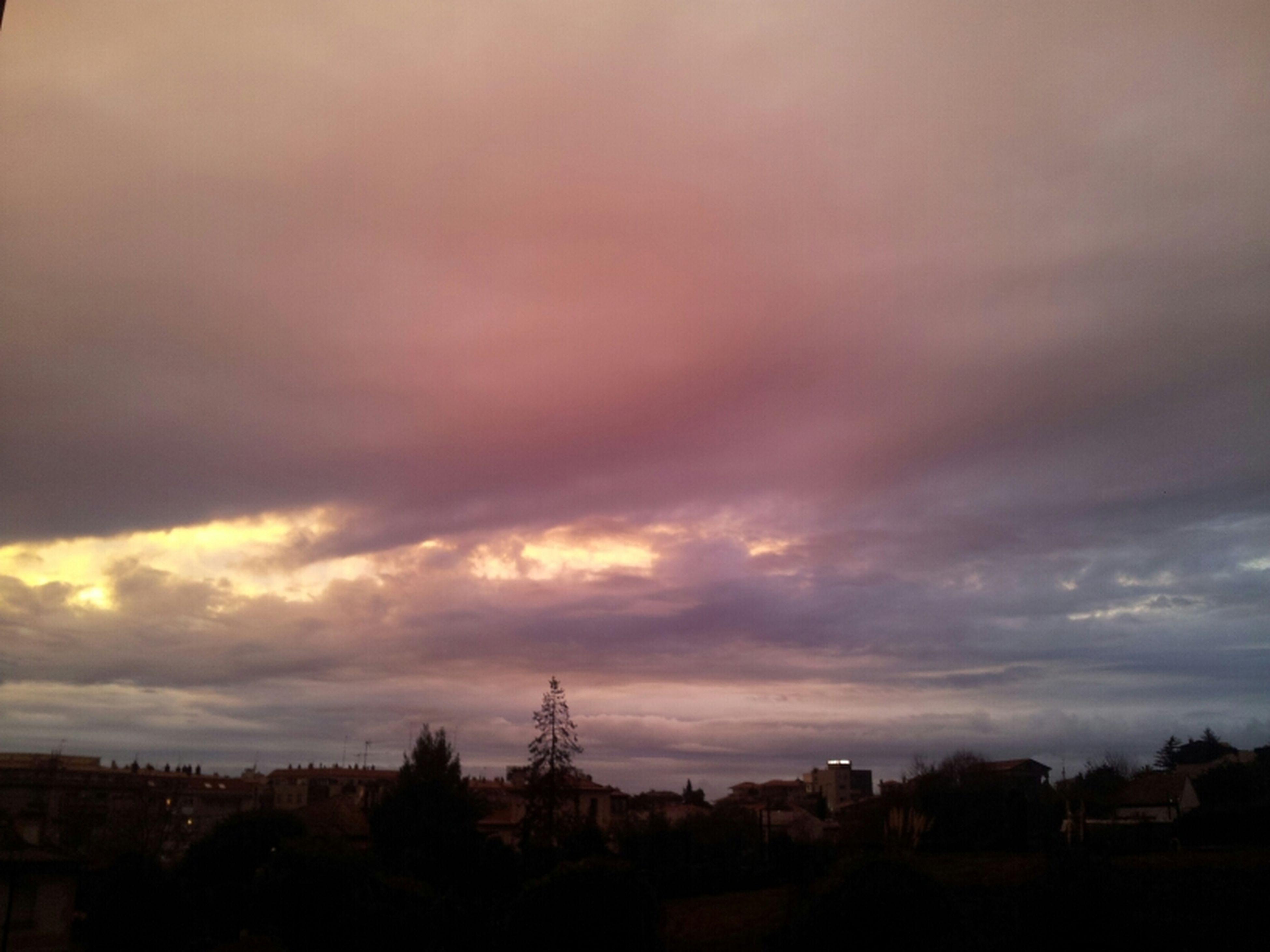 sky, silhouette, cloud - sky, sunset, building exterior, cloudy, built structure, landscape, tree, house, cloud, architecture, dusk, beauty in nature, scenics, nature, electricity pylon, power line, tranquil scene, dramatic sky