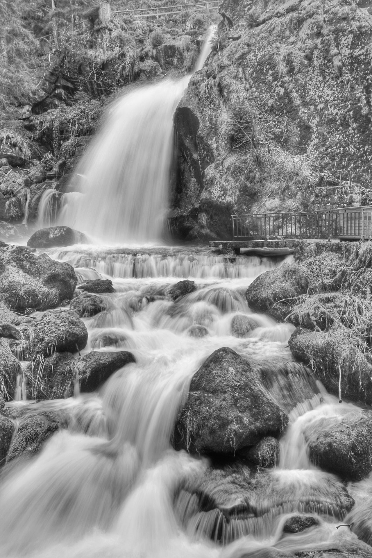 """The Sound of Water"" Waterfall Water Motion Scenics Blurred Motion Long Exposure Nature Beauty In Nature Flowing Water Rock - Object Idyllic Outdoors Tree Day One Person Power In Nature Monochrome Monochrome Photography Blackandwhite Black And White Landscape Michael Hruschka Wasserfall Langzeitbelichtung Wasser"