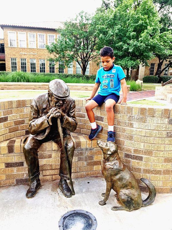 Bronze Statue Man Boy Dog Interaction
