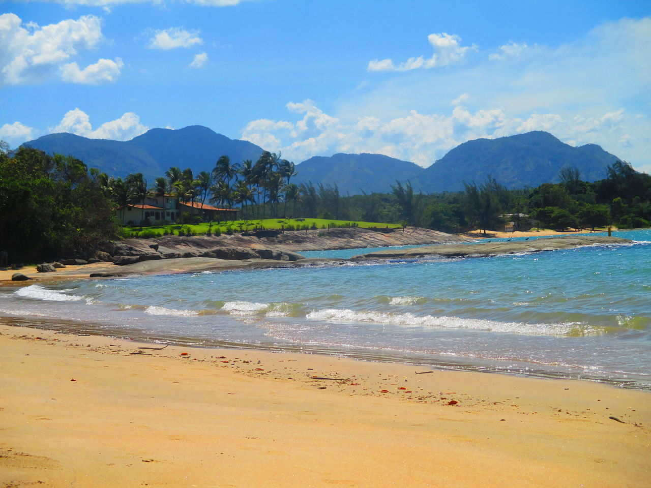 beach, mountain, sky, scenics, beauty in nature, sand, sea, water, nature, shore, tranquil scene, tranquility, cloud - sky, no people, mountain range, outdoors, day, wave, blue, tree, landscape