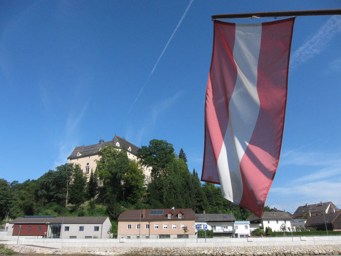 Austrian flag Austria Austrian Flag Architecture Built Structure Day Flag Low Angle View Sky